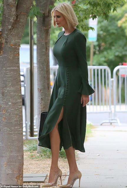 Ivanka Trump flashes some leg as she heads to work in a glamorous green dress with a daring split