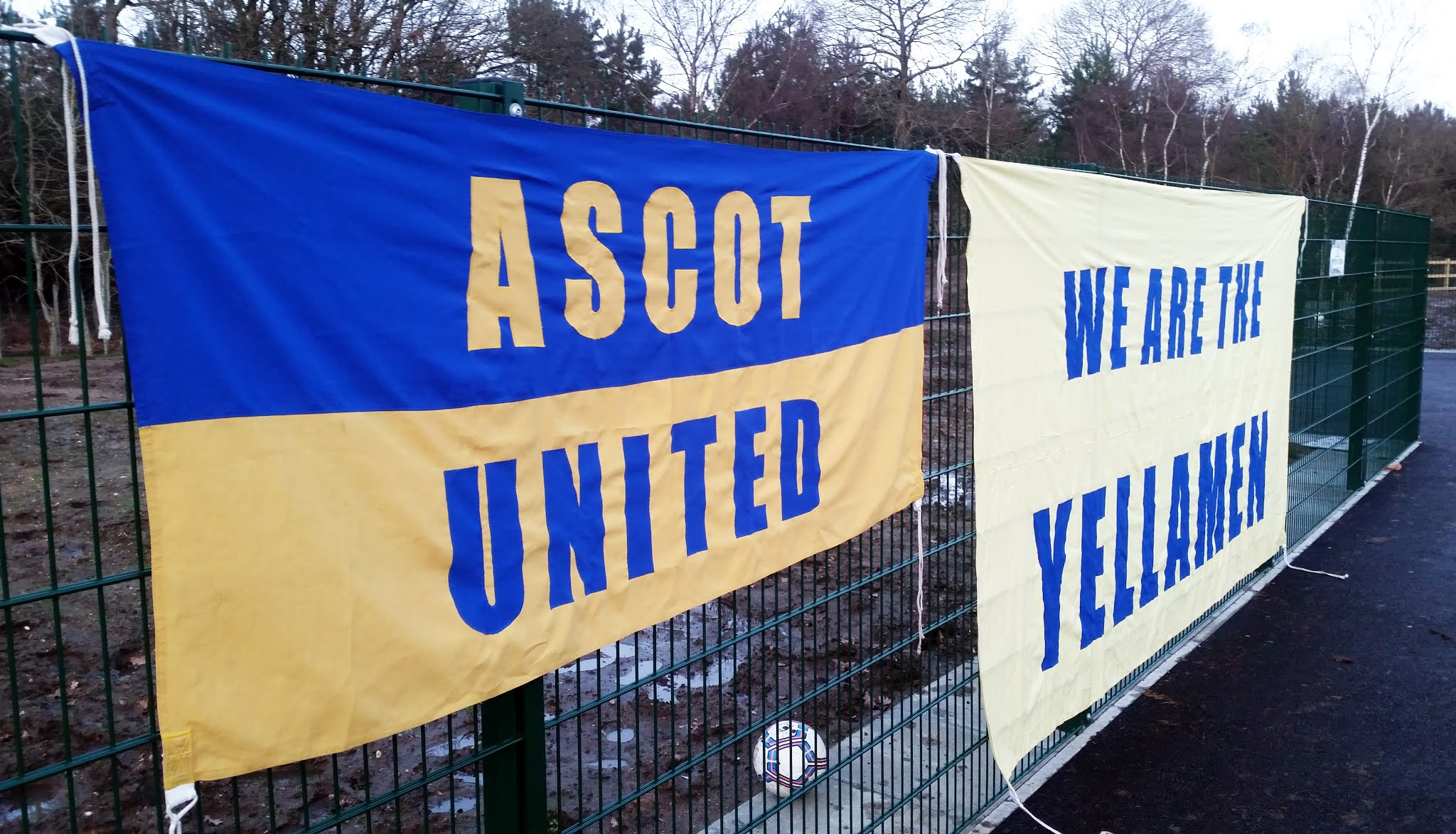 Ascot United banners at the Racecourse Ground
