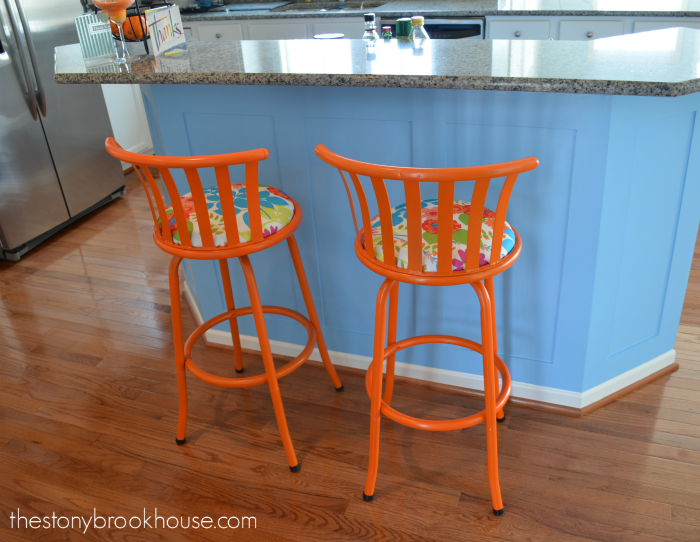 Orange barstools at the bar