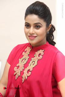 Actress Poorna Latest Stills in Red Dress at Rakshasi First Look Launch  0232.JPG