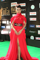 Apoorva in a Stunning Tight Leg Split Sleeveless Red Gown at IIFA Utsavam Awards 006.JPG