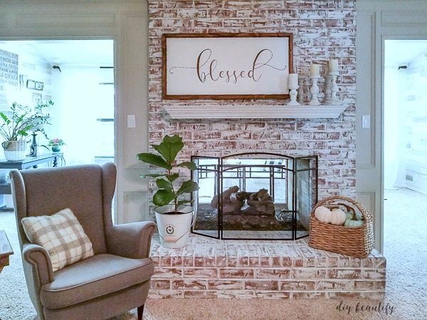 Painting a fireplace to brighten up a room | diybeautify.com