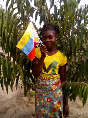 Members of the Eternal Love Church of Guanduania display their church flag