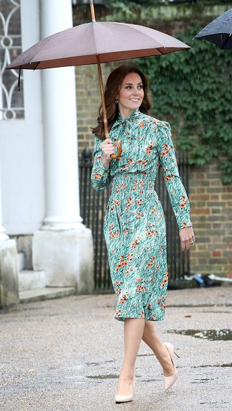 Kate Middleton wore Prada Printed silk dress, Monica Vinader Gold Vermeil Earrings and LK Bennett Fern pumps. Prince Harry