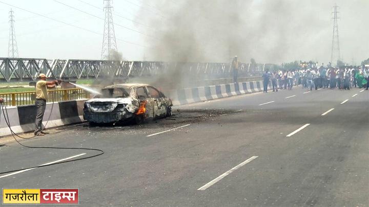 car burnt on brajghat highway