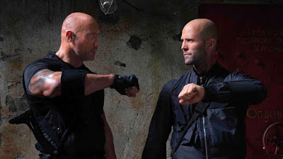Movie still for the new Fast and Furious film Hobbs and Shaw where Dwayne Johnson and Jason Statham argue in military gear before they go into battle