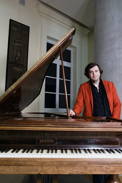 Hubert Rutkowski, artistic director of the Chopin Festival Hamburg, with the 1847 Pleyel piano being used at the festival