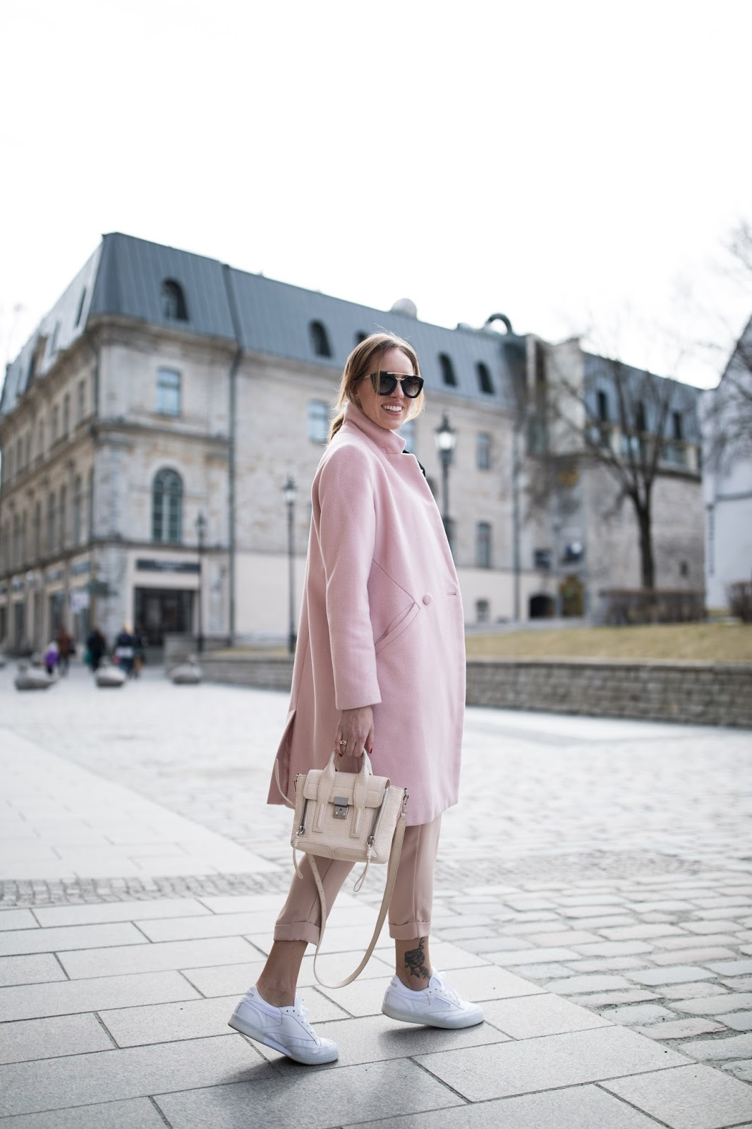 pink coat white sneakers minimalist outfit