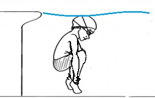 Image of a boy grabbing his ankles under water. Another of the games for swimming lessons