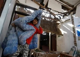 A boy shows how he survived an earthquake.