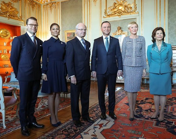 Poland's President Andrzej Duda and his wife Agata Kornhauser-Duda. Crown Princess wore Yves Saint Laurent Suede Pumps, Greta midi dress in blue, Dolce Gabbana handbags, Ebba Brahe earrings