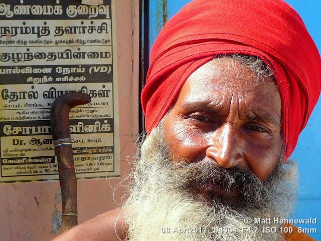 © Matt Hahnewald, Facing the World, close up, street portrait, Dravidian people, South India, Rameshwaram, headshot, Hindu man, sadhu, red turban, white beard