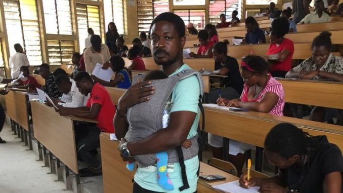 Shocking!! Unical lecturer baby sits his students child during an exam