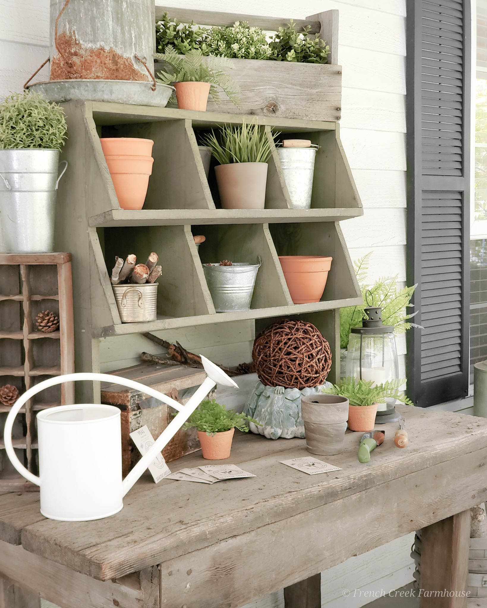 A chicken nesting box creates cubbies for storing our gardening supplies