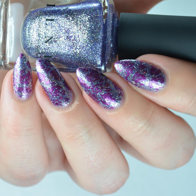 purple nail polish with flowers