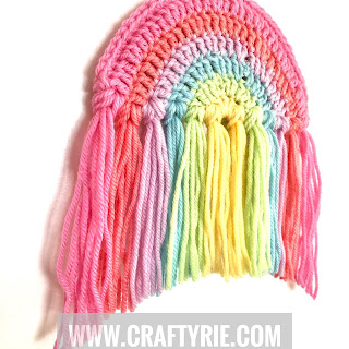 A fun, easy to make crochet rainbow to hang in your window to cheer everyone up!
