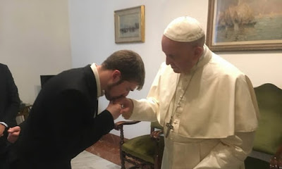 "This photo of Tom Evans kissing the Pope's hand in the Vatican appeared on the Facebook of ""Alfies Army."""