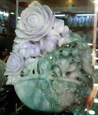 A jade carving with a blend of green and white color