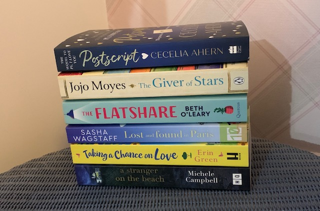 Pile of books on a bedside table