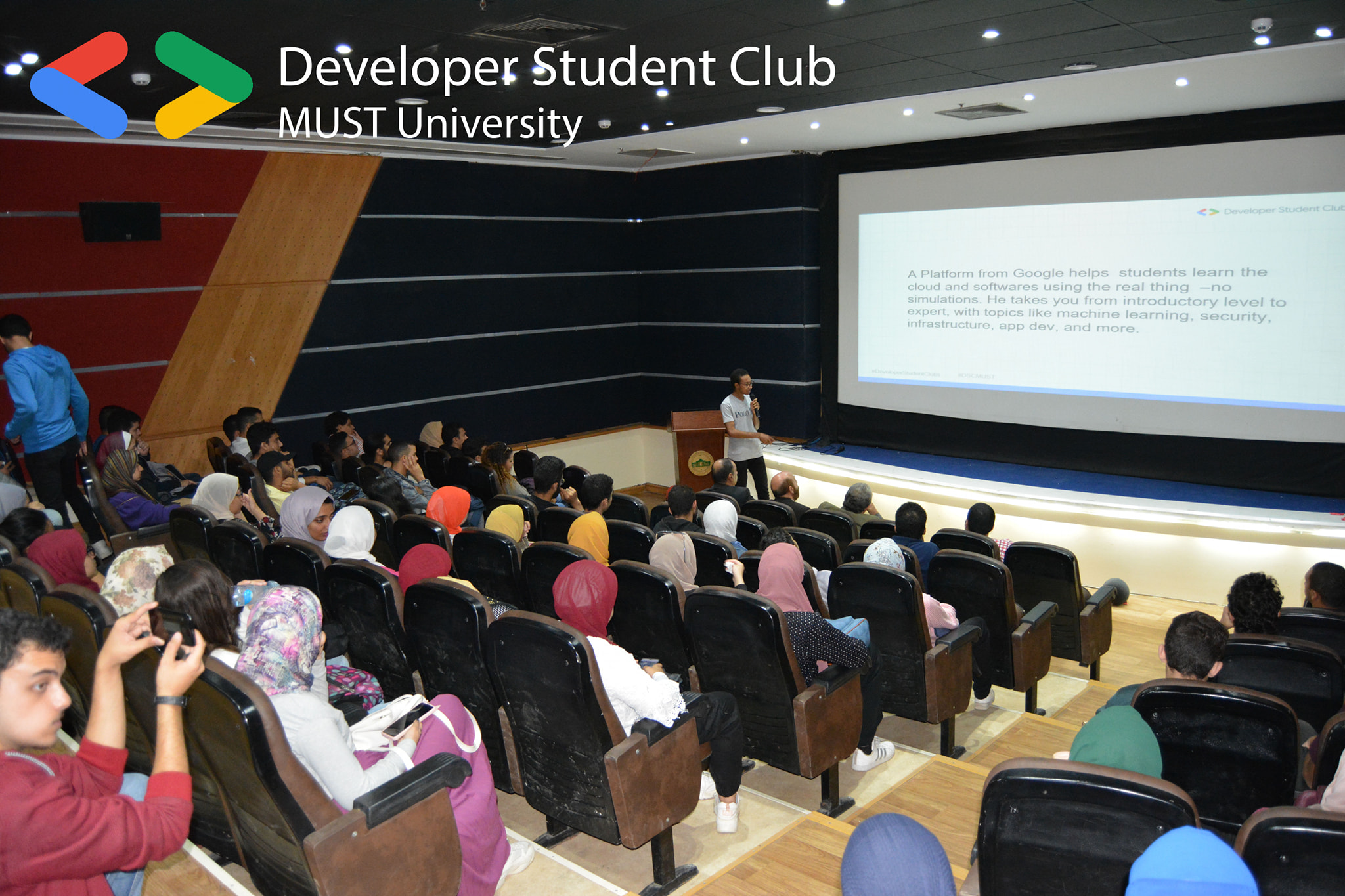 A classroom of people attend a GDSC MUST speaker session