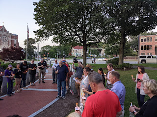 a brief candle light walk on the Common to the Veterans Walkway for a final prayer