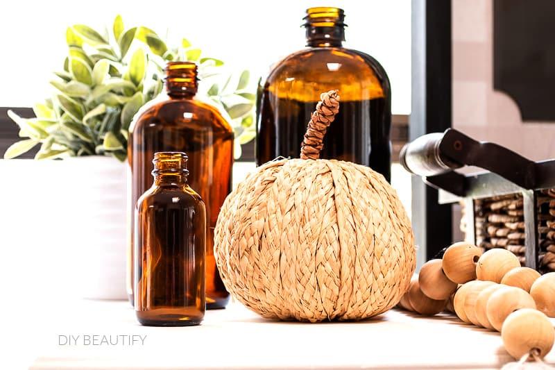amber brown glass bottles in Fall vignette