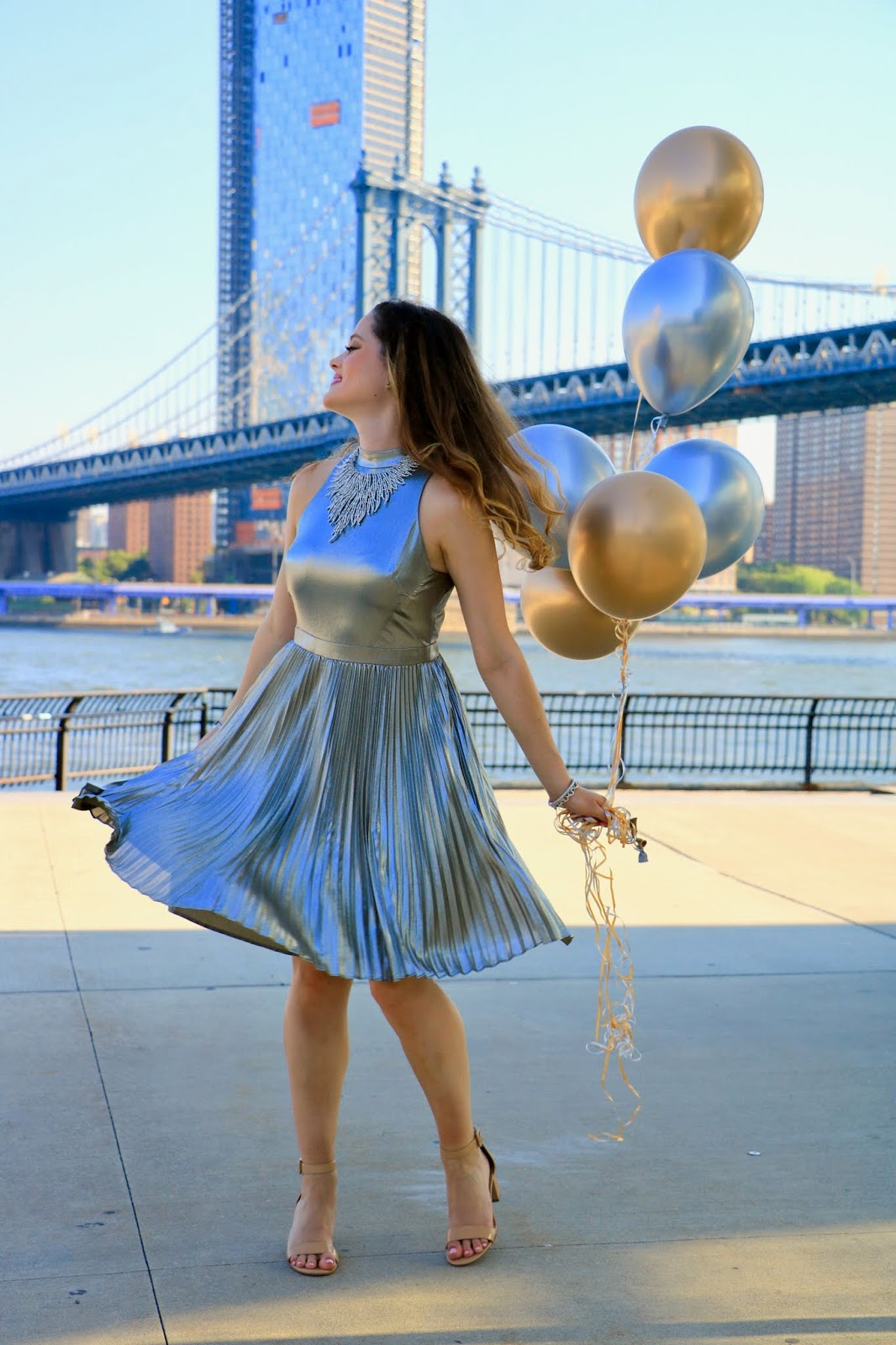 Fashion blogger Kathleen Harper doing a photo shoot with balloons in NYC