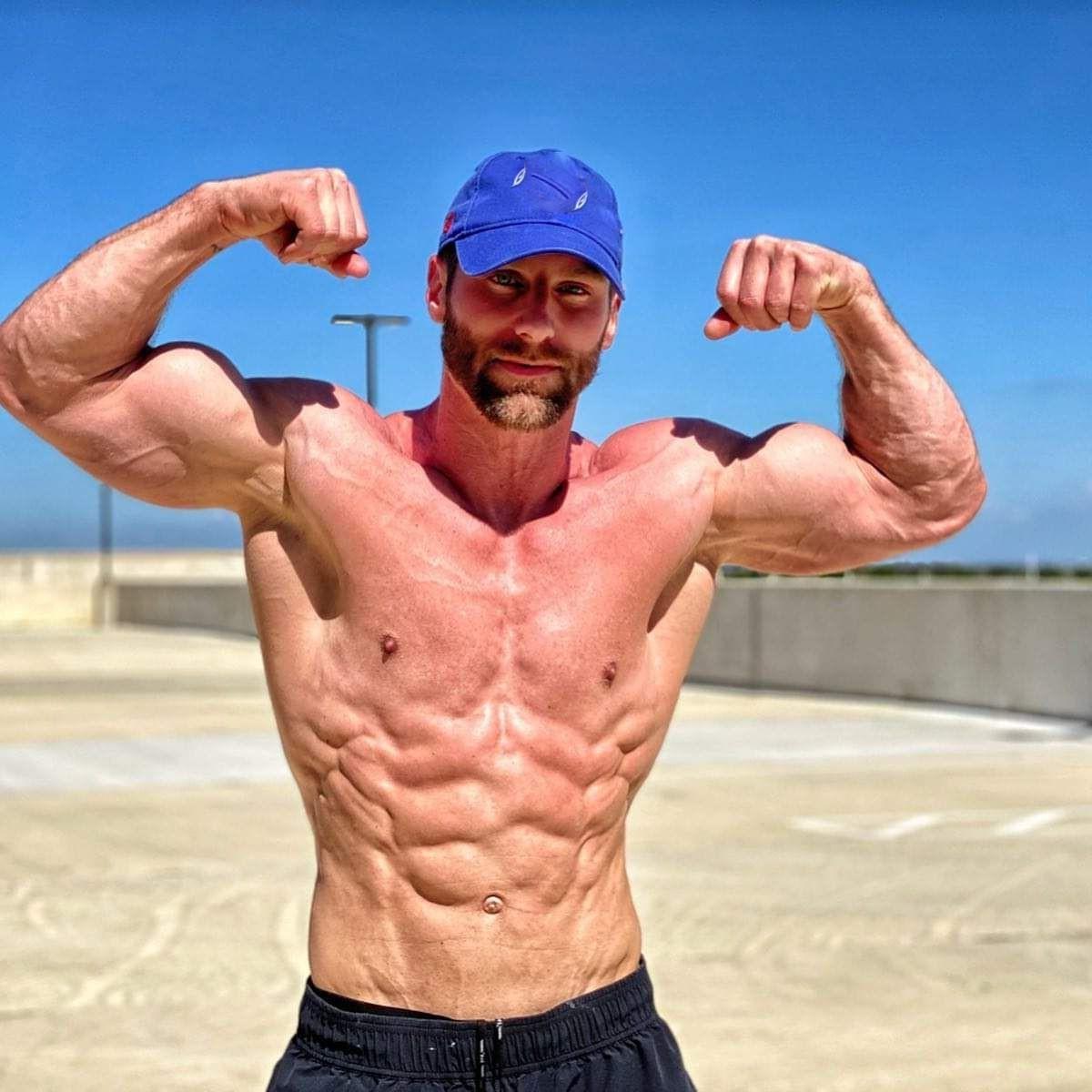 muscular-shirtless-man-abs-biceps-flex