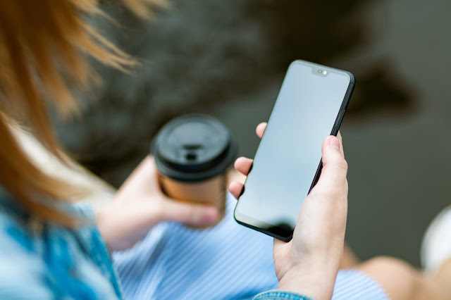 A person holding a smartphone