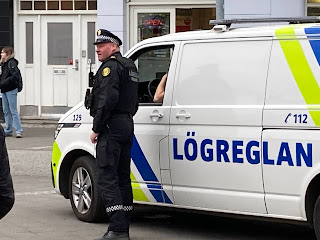 Icelandic police man and police van photo by Michael Ridpath