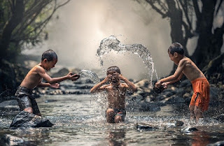 Hilarious childhood: playing under the rain