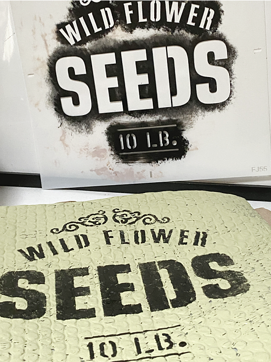 stenciling with an old sign stencil seed stencil