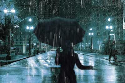 Mulher com guarda-chuva em São Paulo à noite