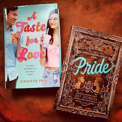 Two books on a cloth. A Taste for Love and Pride.