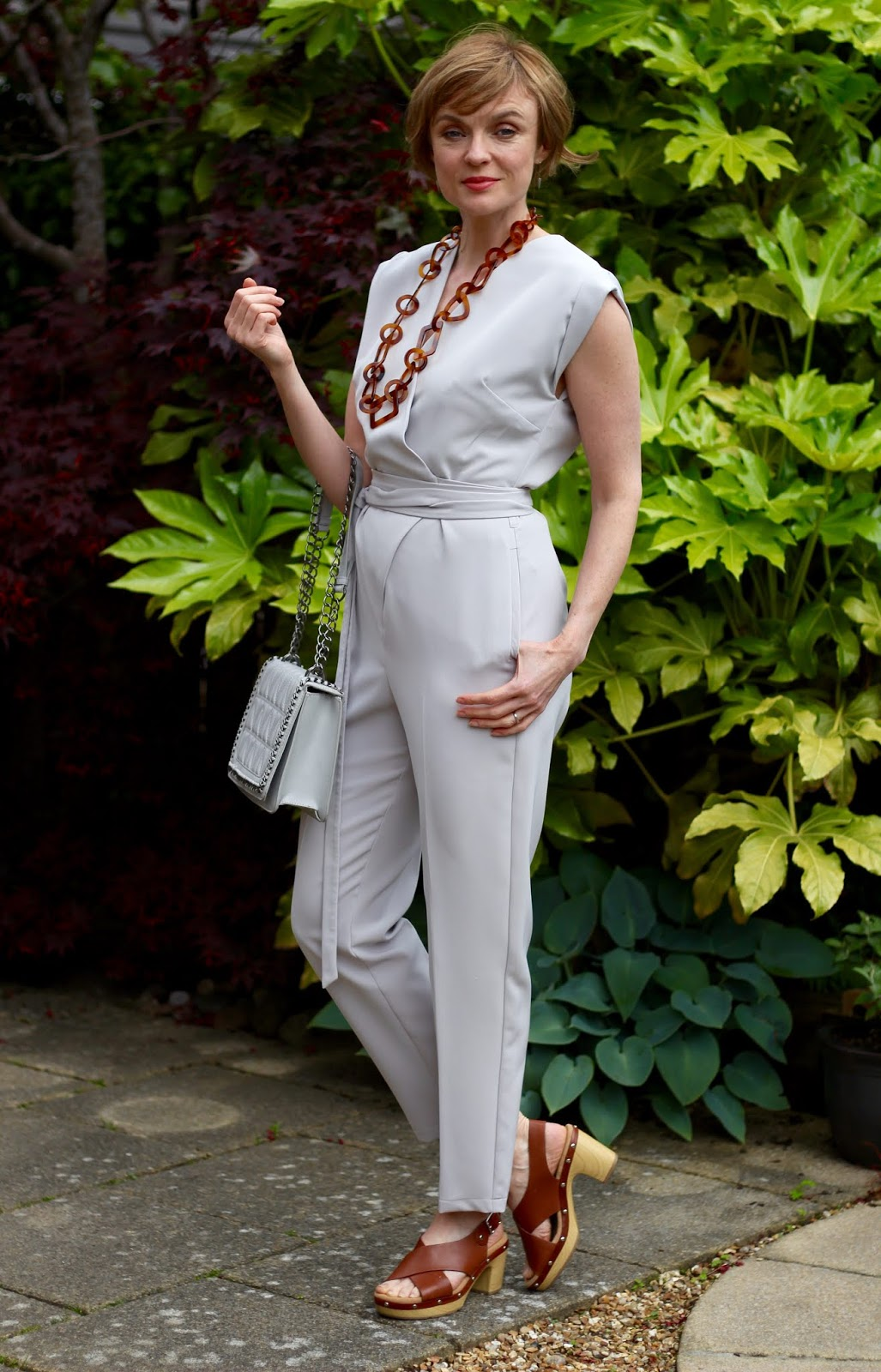 Pale grey jumpsuit, tan necklace and sandals | Fake Fabulous | Summer outfit