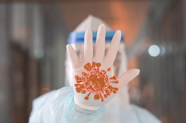 Asian-Doctor-stand-in-front-of-the-corona-virus-or-covid-19-with-rejection-gesture