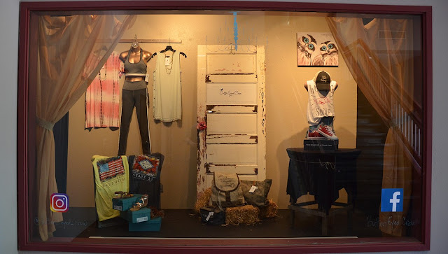Window display with shirts and other apparel