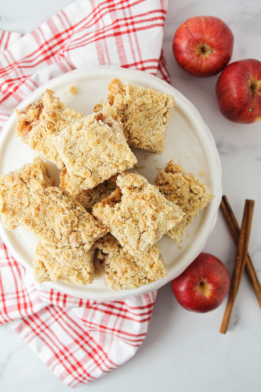 These sweet and buttery apple cinnamon crumb bars have two tender crumb layers surrounding a luscious apple filling. They're so delicious!