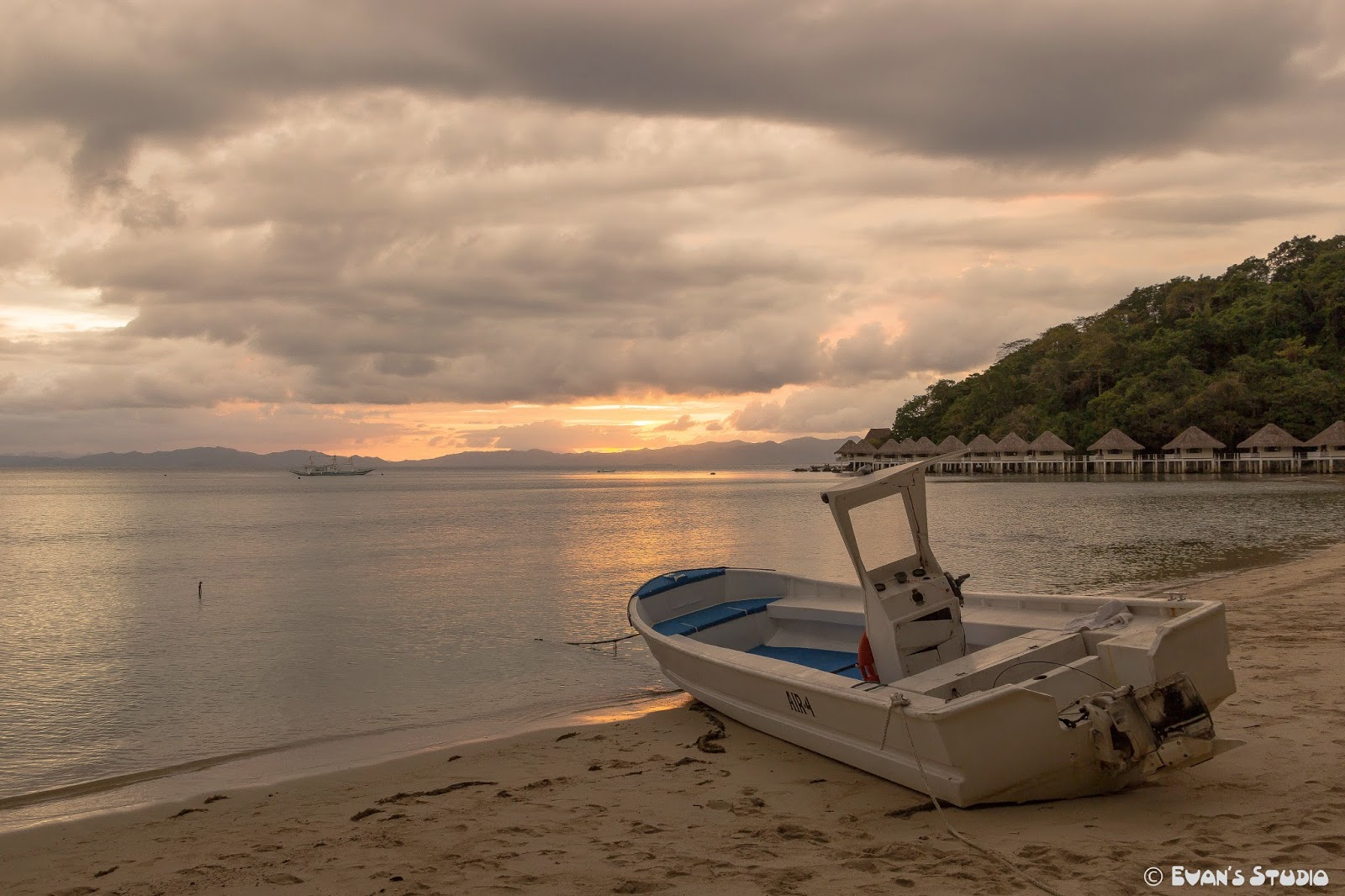 An Apulit Island sunset with the air4 motor boat in the foreground.