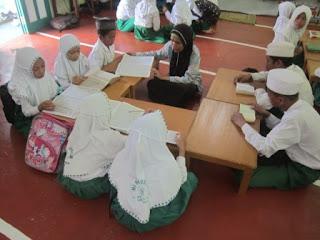 Pengembangan Baca Tulis Al Qur'an MI Al Raudlah