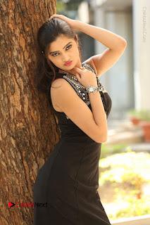 Actress Poojitha Pallavi Naidu Stills in Black Short Dress at Inkenti Nuvve Cheppu Movie Platinum Disc Function  0061.JPG