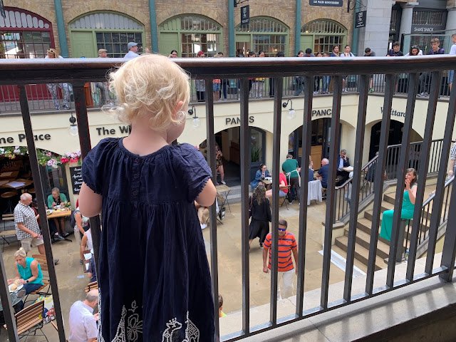 Child watching a lady singing opera in Covent Garden Market