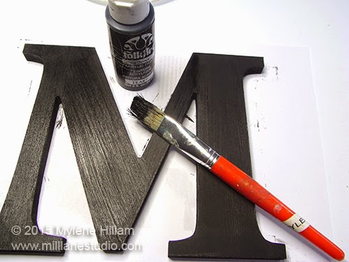 "Wooden ""M"" has been painted with two coats of Folk Art Licorice paint"