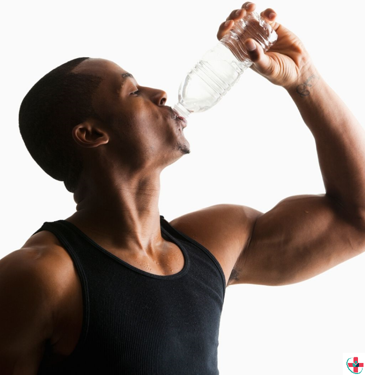 MUSCULAR MAN DRINKING WATER