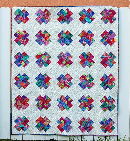 Kisses Scrappy Strip Quilt designed by Caroline of SewCanShe