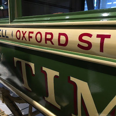 Hand-painted lettering on an old omnibus at the London Transport Museum