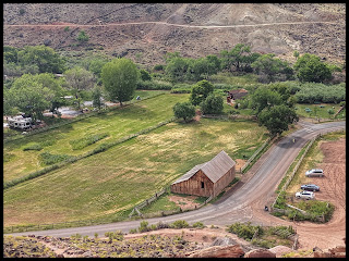 Looking down from the switchbacks on the Cohab Canyon trail to the parking lot, barn, campground and the bakery is in the clump of trees behind the barn.