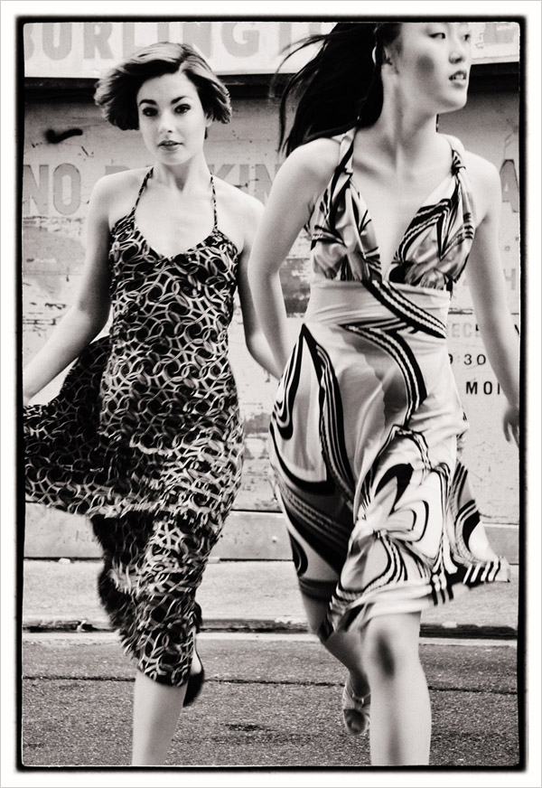 Ashlee and Sunny running across a lane in vintage maxi dresses, black and white photograph  - Chinatown 2007 New Edition, Fashion photography by Kent Johnson