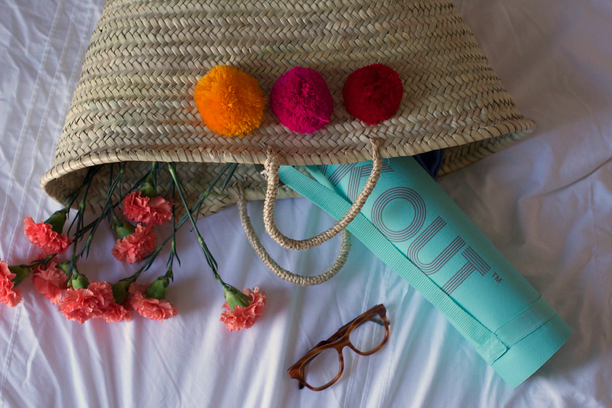 perfect for yoga or weekend market trips, the pom pom basket bag
