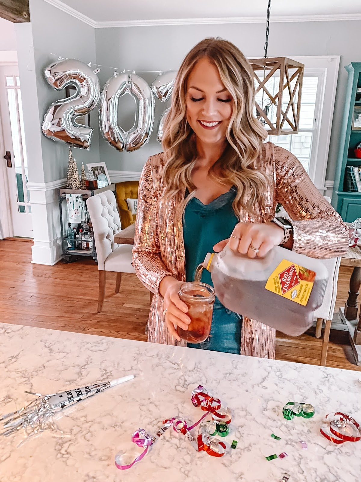 OKC blogger Amanda Martin pours Red Diamond tea for her New Years Eve get-together